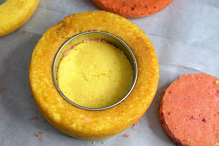Yellow cake with a ring cutting a circle in the middle.