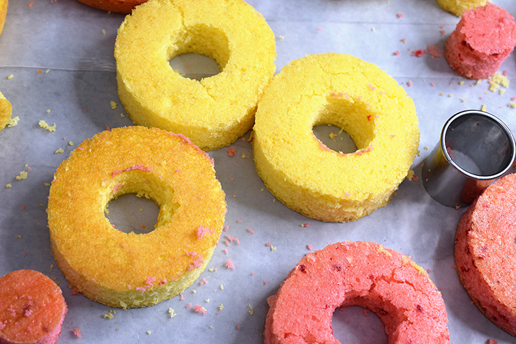 Cake rings and a circle cookie cutter on a table.