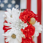 Flowers in front of an American flag with the words Easy and Fun 4th of July Crafts.
