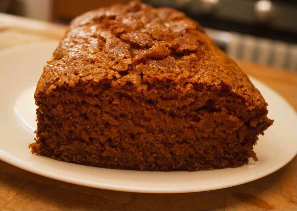 Loaf of pumpkin bread sitting on a plate.
