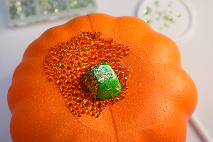 Faux pumpkin with rhinestones on the top.