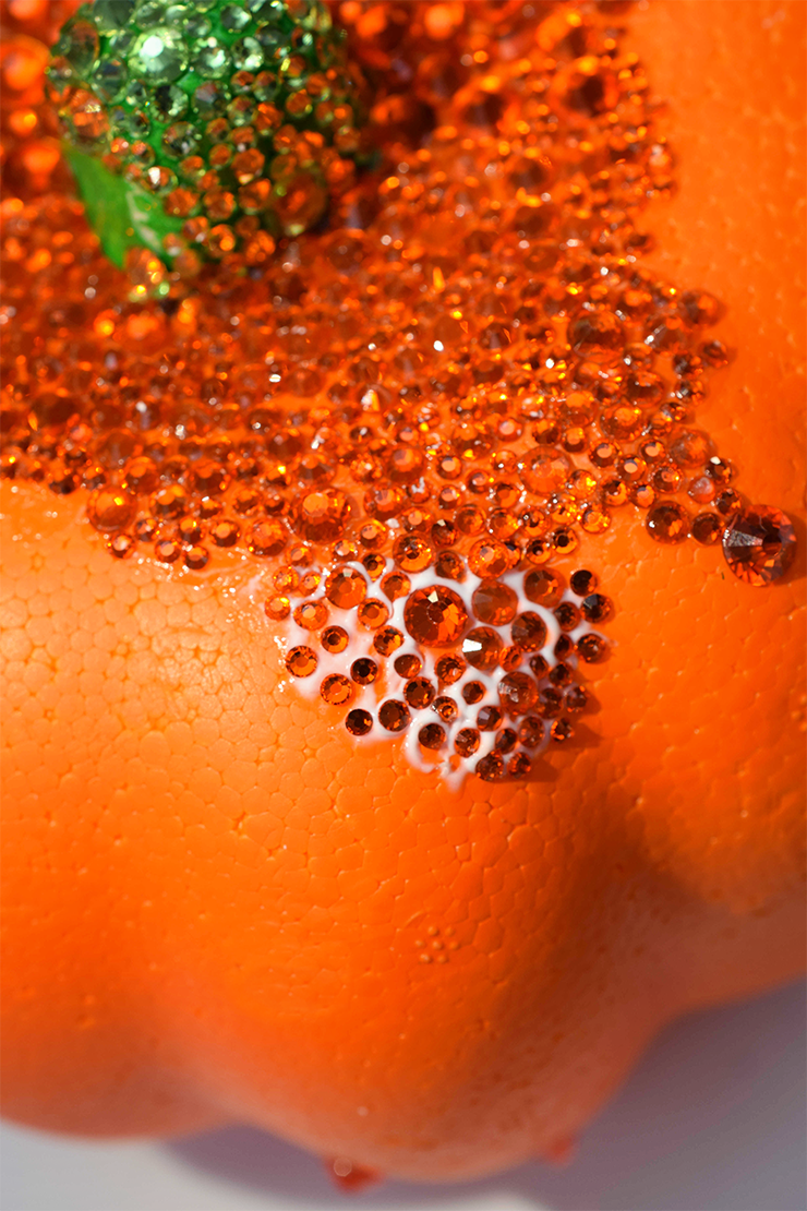 Close up look at a styrofoam pumpkin with rhinestones on it.